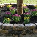 Pat de flori rotund cu bordura din piatra